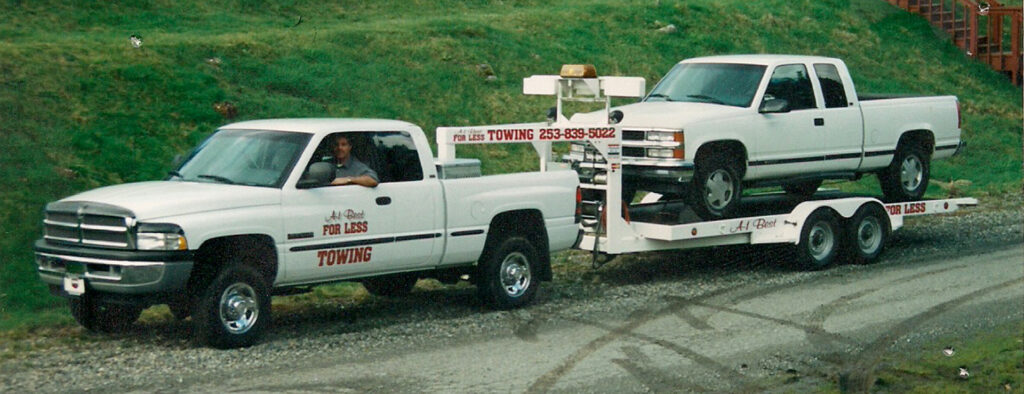 car hauler towing a pick up truck